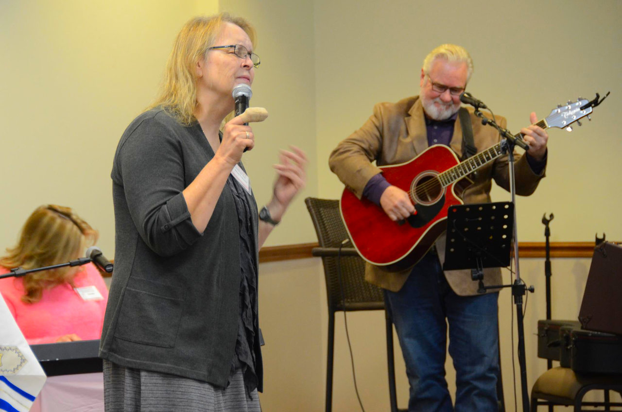 Brother Ronnie and sister Becky Tramell praising on stage