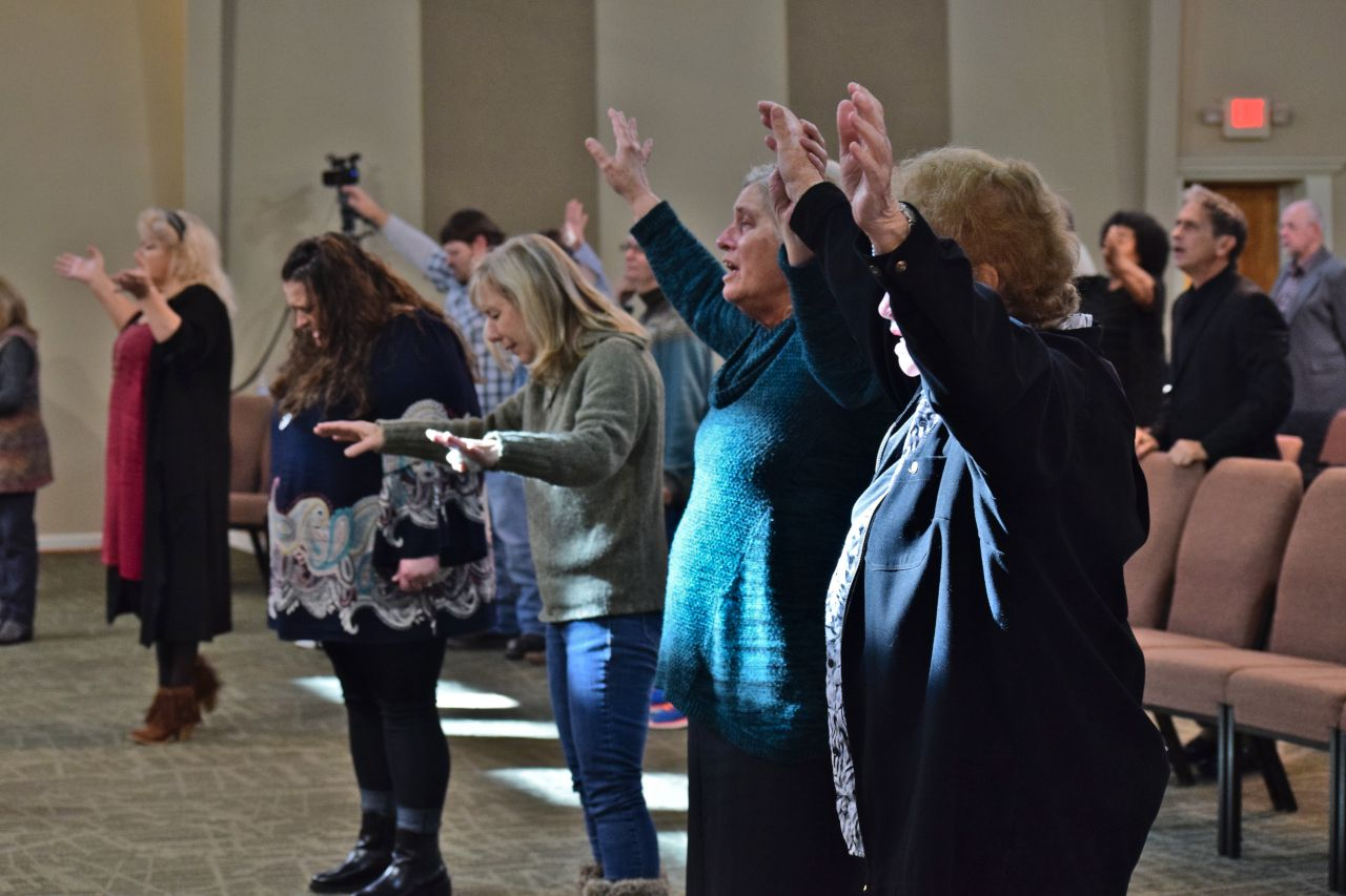 URC Members worshiping at Altar